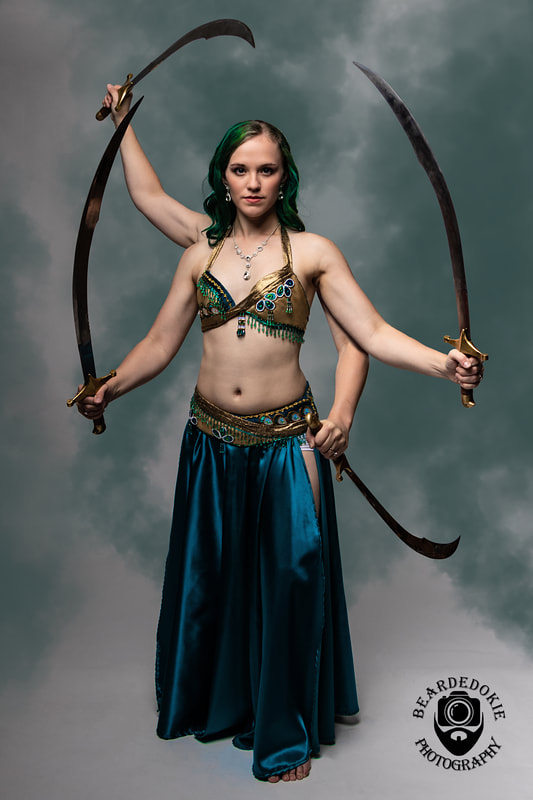 Photographer Instagram: @beardedokiephotography  Model Instagram: @caliadne.amar ) Troupe: @aalimokc . . #bellydance #bellydancer #sword #swords #smoke #dnd #dungeonsanddragons #goro #mortalkombat #shiva #greenhair #tealhair #bluehair #oklahomaartist #oklahoma #oklahomacity #oklahomaphotographer #model #fourarms #combat #warrior